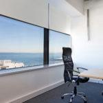Roller Blinds In Office Building | Sol Shutters & Blinds